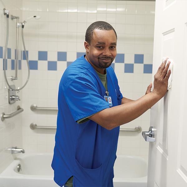 Employee Cleaning in Bathroom